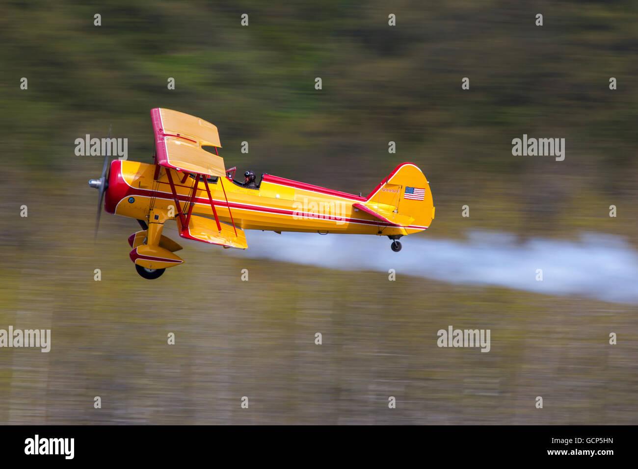 Bi-plane in flight near Valdez, Southcentral Alaska, summer Stock Photo