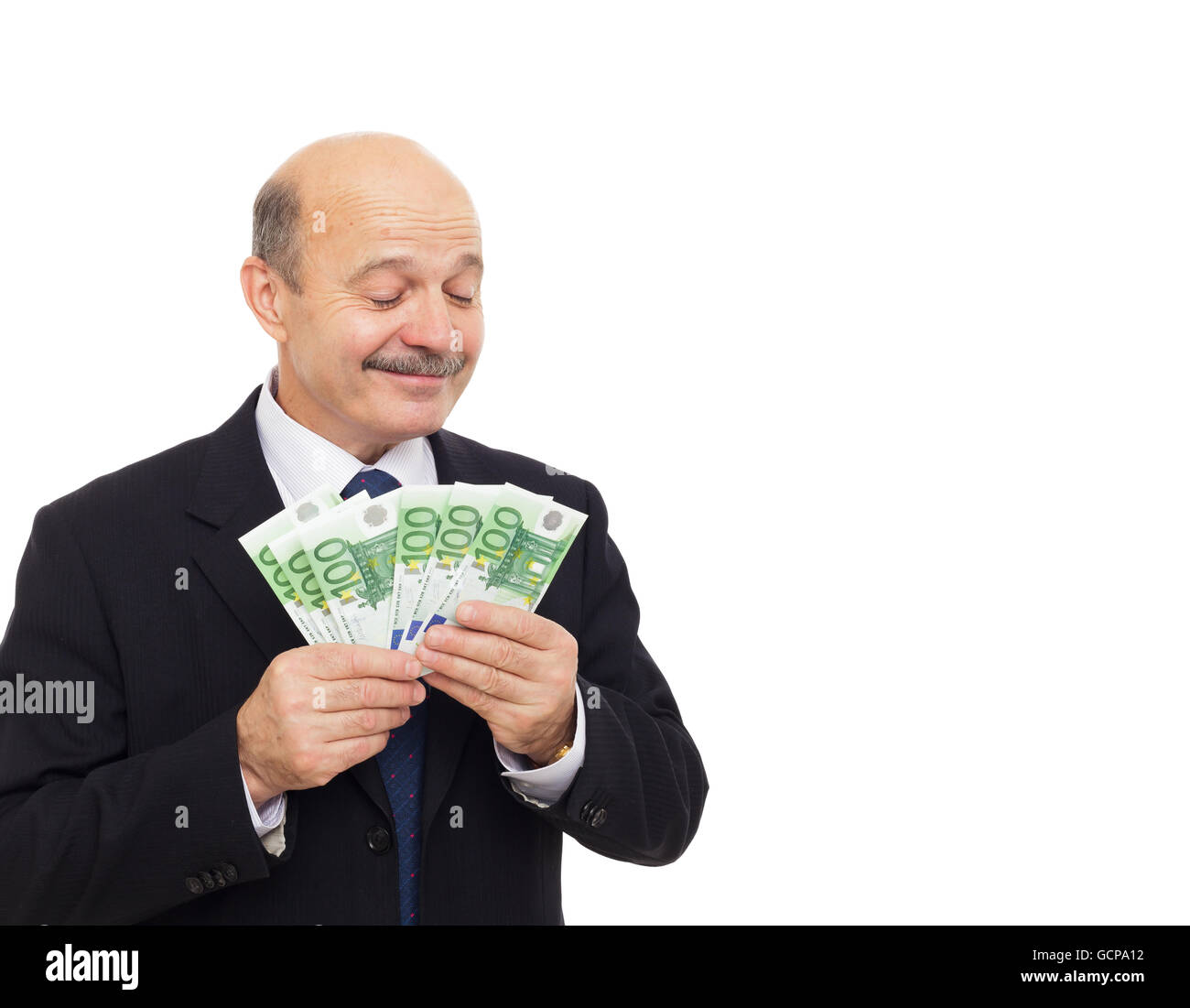 Elderly man holds in his hand a wad of money and showing sign okay Stock Photo