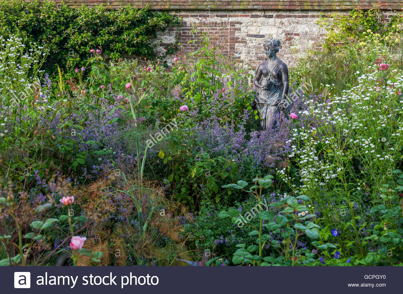 female figurative lead statue focal point - Stock Image