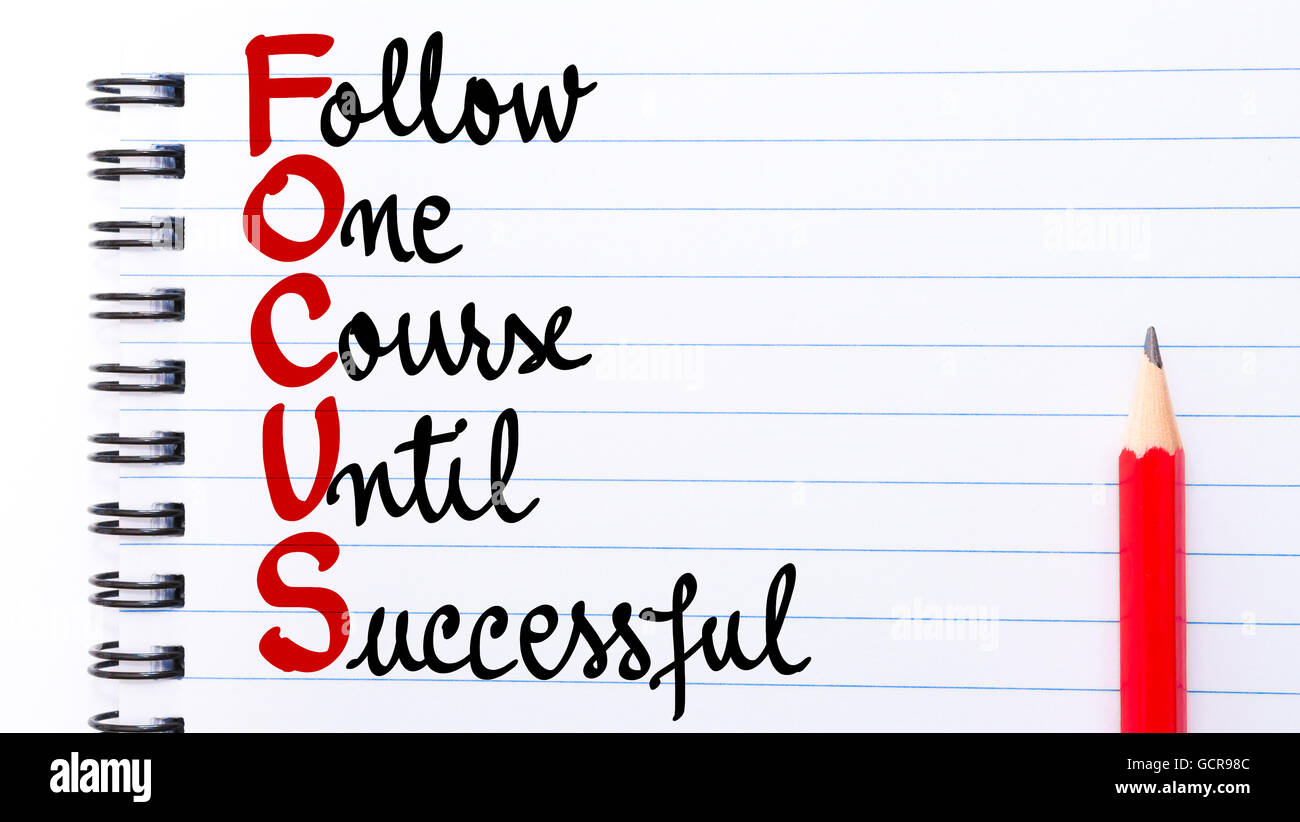 FOCUS Follow One Course Until Successful written on notebook page with red pencil on the right - Stock Image
