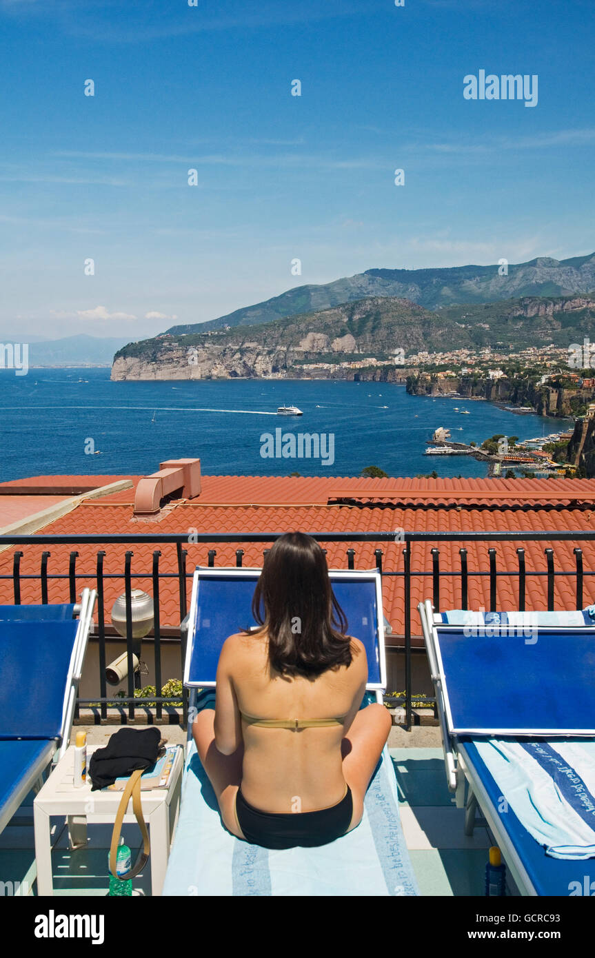 Enjoying the view and the sunbathing on a hotel terrace overlooking Sorrento, near Naples, Italy Stock Photo