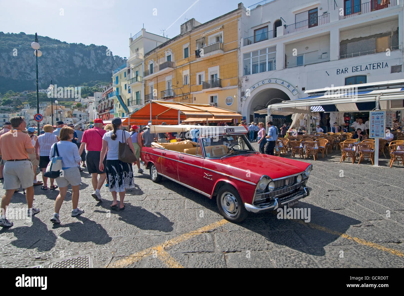 An ancient but pristine open topped car serves as a taxi on the Isle of Capri in the Bay of Naples, Italy - Stock Image