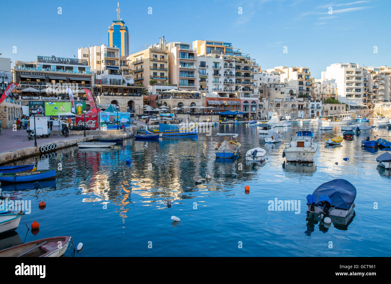 Spinola bay area of St.Julian's Bay with bars restaurants and nightlife, Malta - Stock Image
