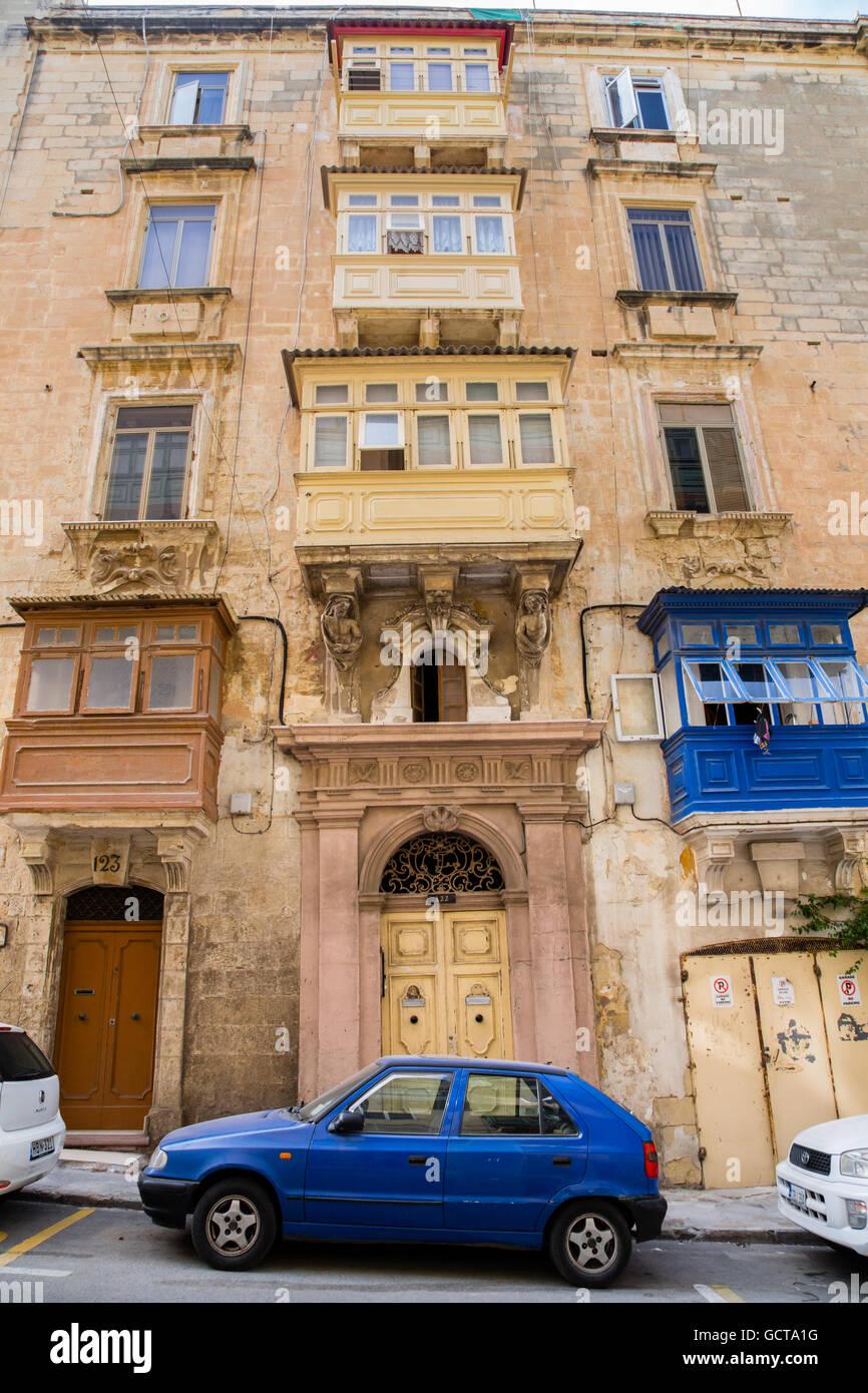 Valletta buildings scene showing characteristic Maltese balconies, Malta - Stock Image
