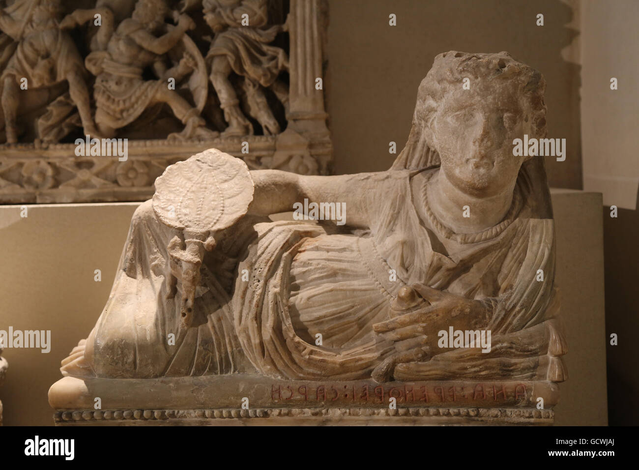 Etruscan art. Cinerary urn. Effigy of the deceased. Woman wearing jewelry and holding a fan in her right hand and, - Stock Image