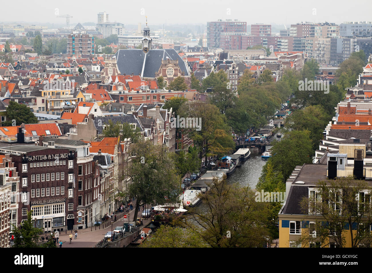 View from the Westerkerk on the Prinsengracht canal and the Norderkerk church, Amsterdam, Holland, Netherlands, - Stock Image