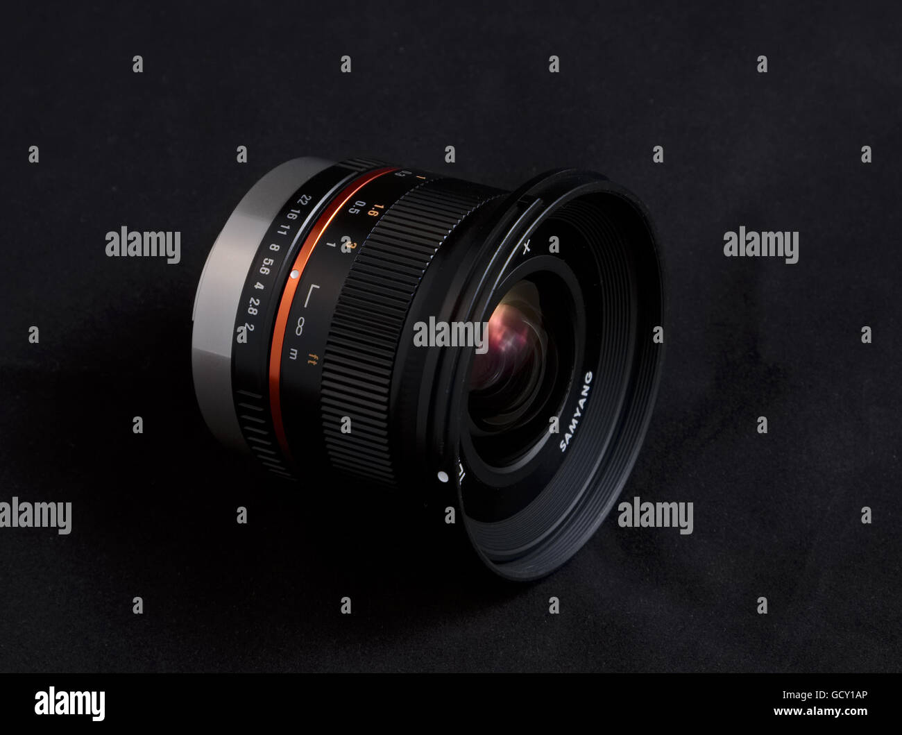 A wide angle camera lens on a black background - Stock Image