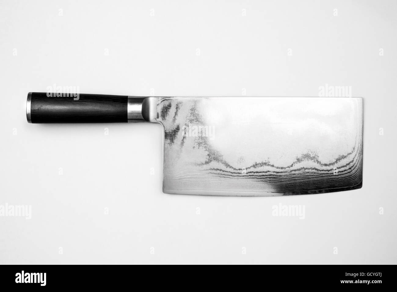 steel kitchen knife on pink background - Stock Image