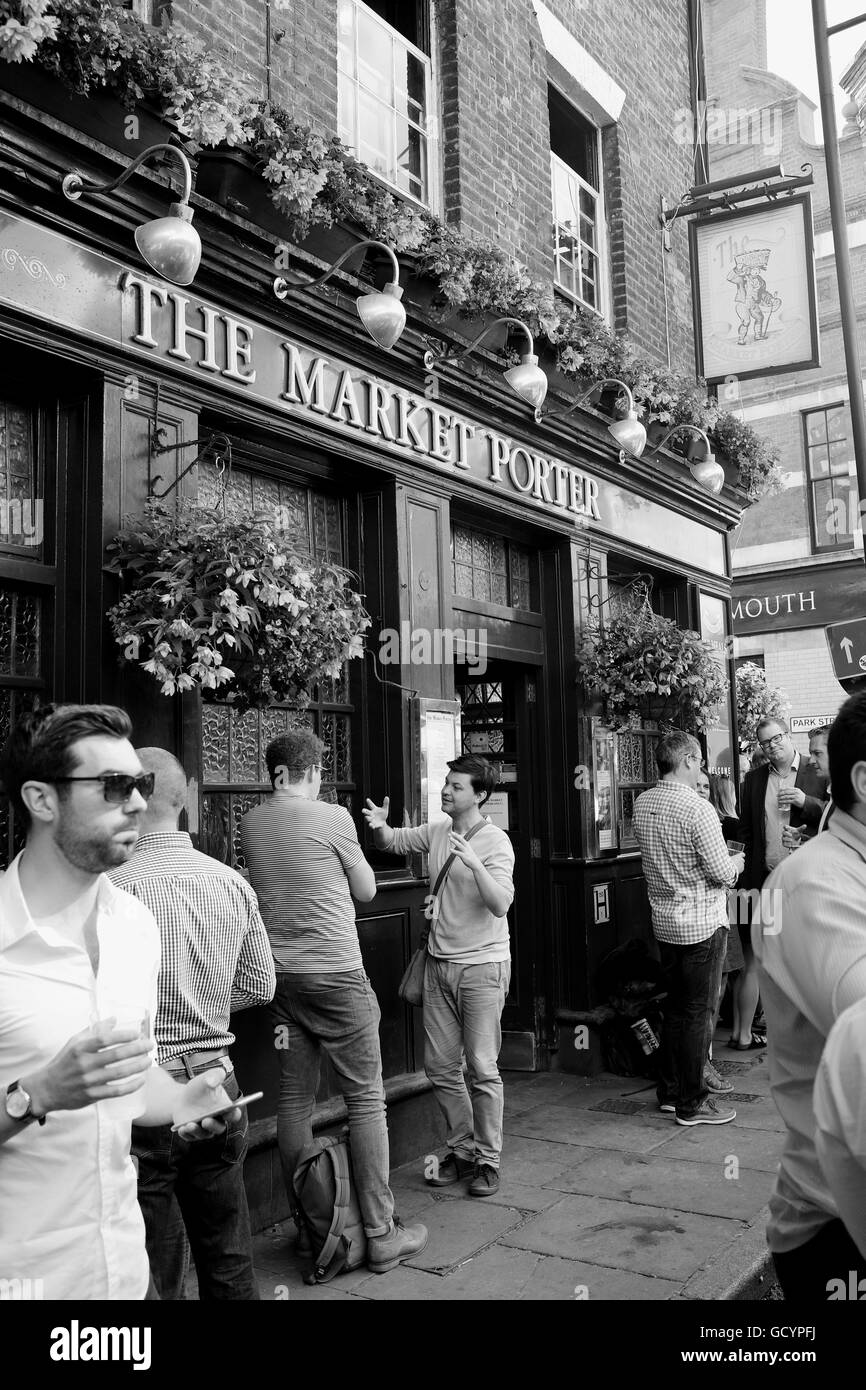 People drinking outside the Market Porter Pub in Borough Market London UK - Stock Image