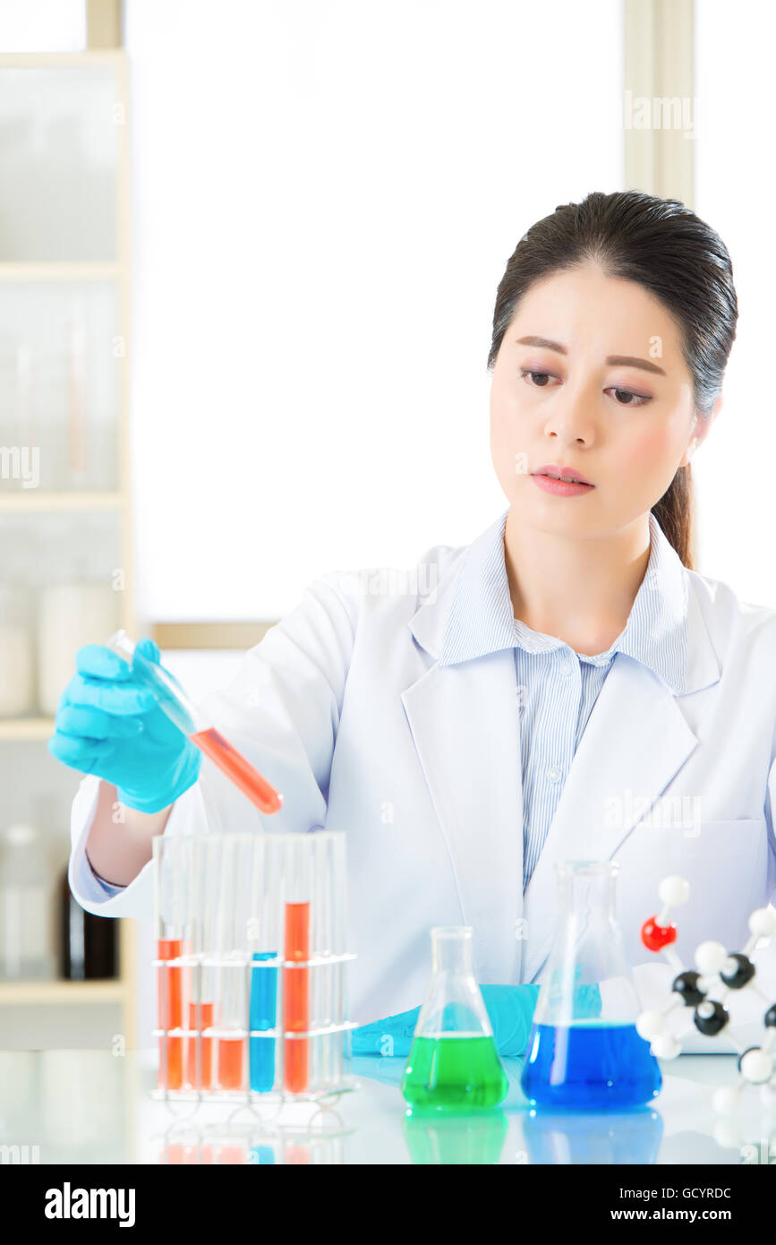 Asian female forensic scientist braving new medical frontiers in laboratory - Stock Image