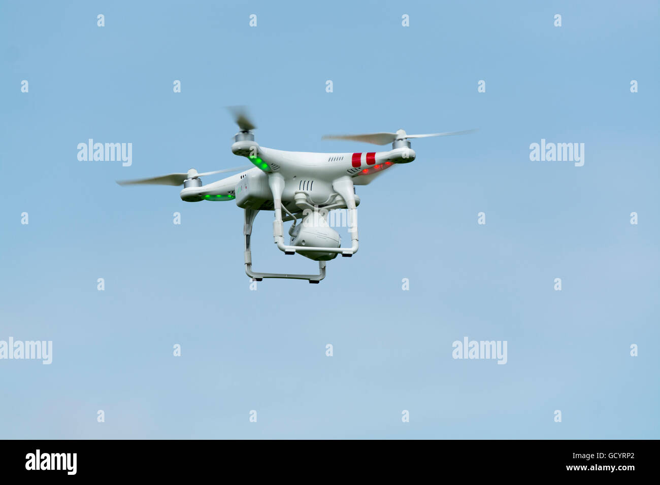 Camera drone in action in countryside, UK. - Stock Image