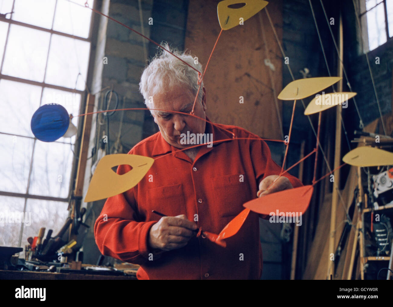 Alexander Calder in his studio, at his home in Roxbury, Connecticut. - Stock Image