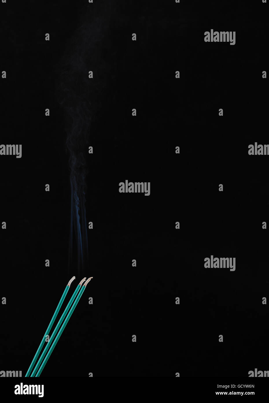 tree green incense sticks dispersing a delightful aroma on a black background. Free space for text - Stock Image