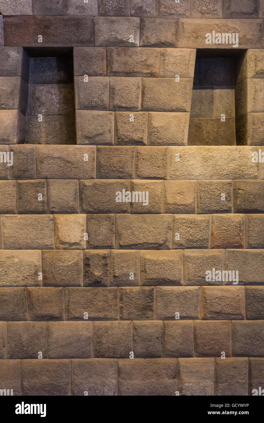 Illuminated Incan wall at the Koricancha archaeological museum in Cusco, Peru - Stock Image
