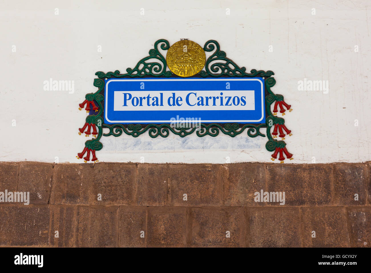 Cusco street sign with the national flower of Peru called Cantuta Stock Photo