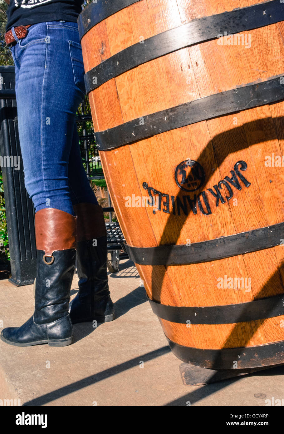 A Woman S Legs In Tight Jeans Tucked Into Riding Boots
