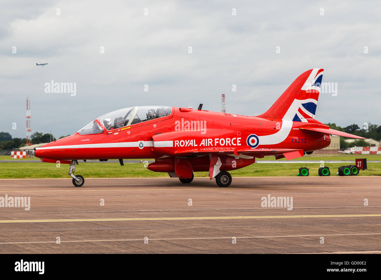 An Air Cadet waves from her back seat of a Red Arrow at the 2016 Royal International Air Tattoo. Stock Photo