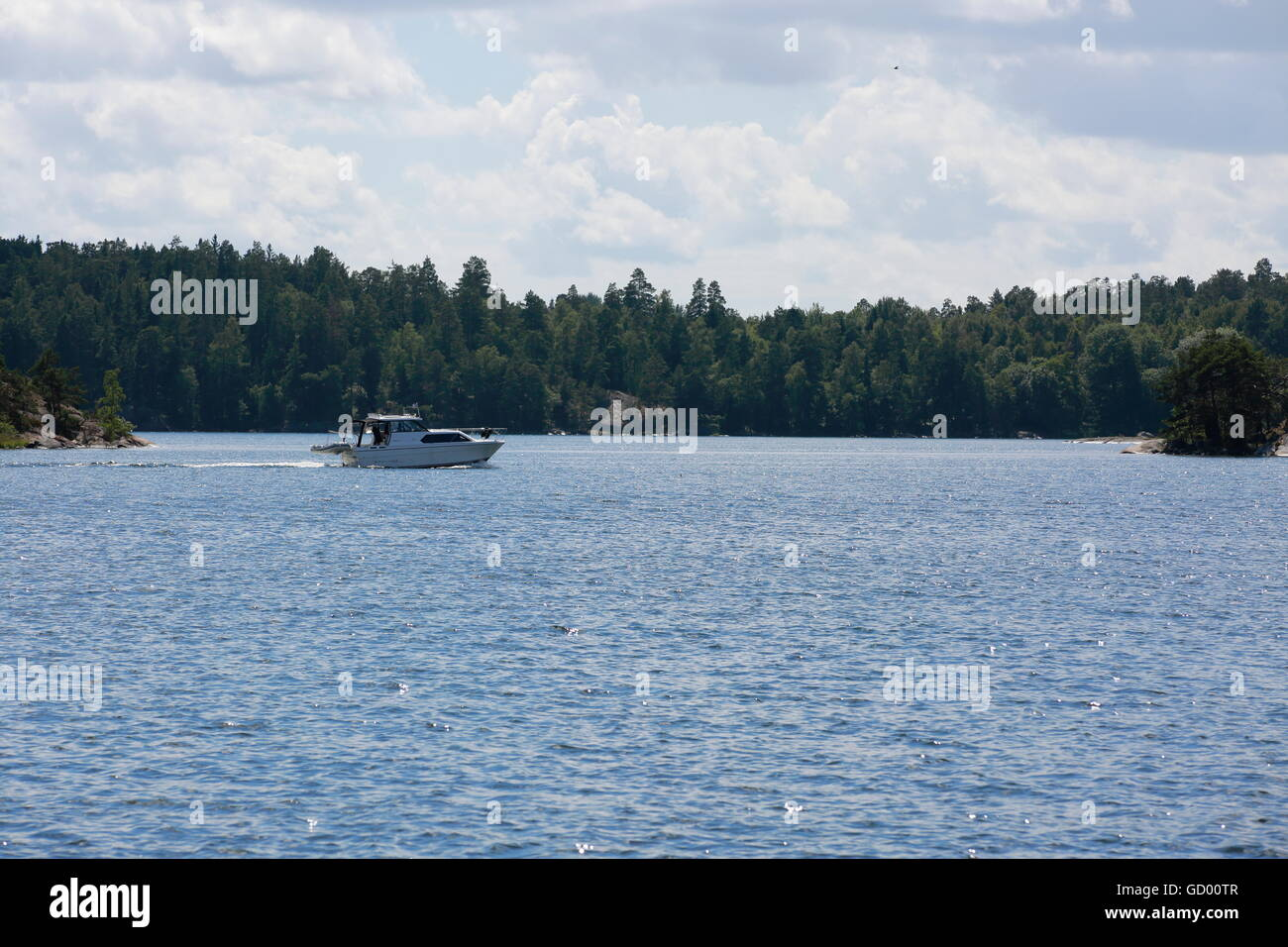 A boat in Stockholm archipelago on a summer day. - Stock Image