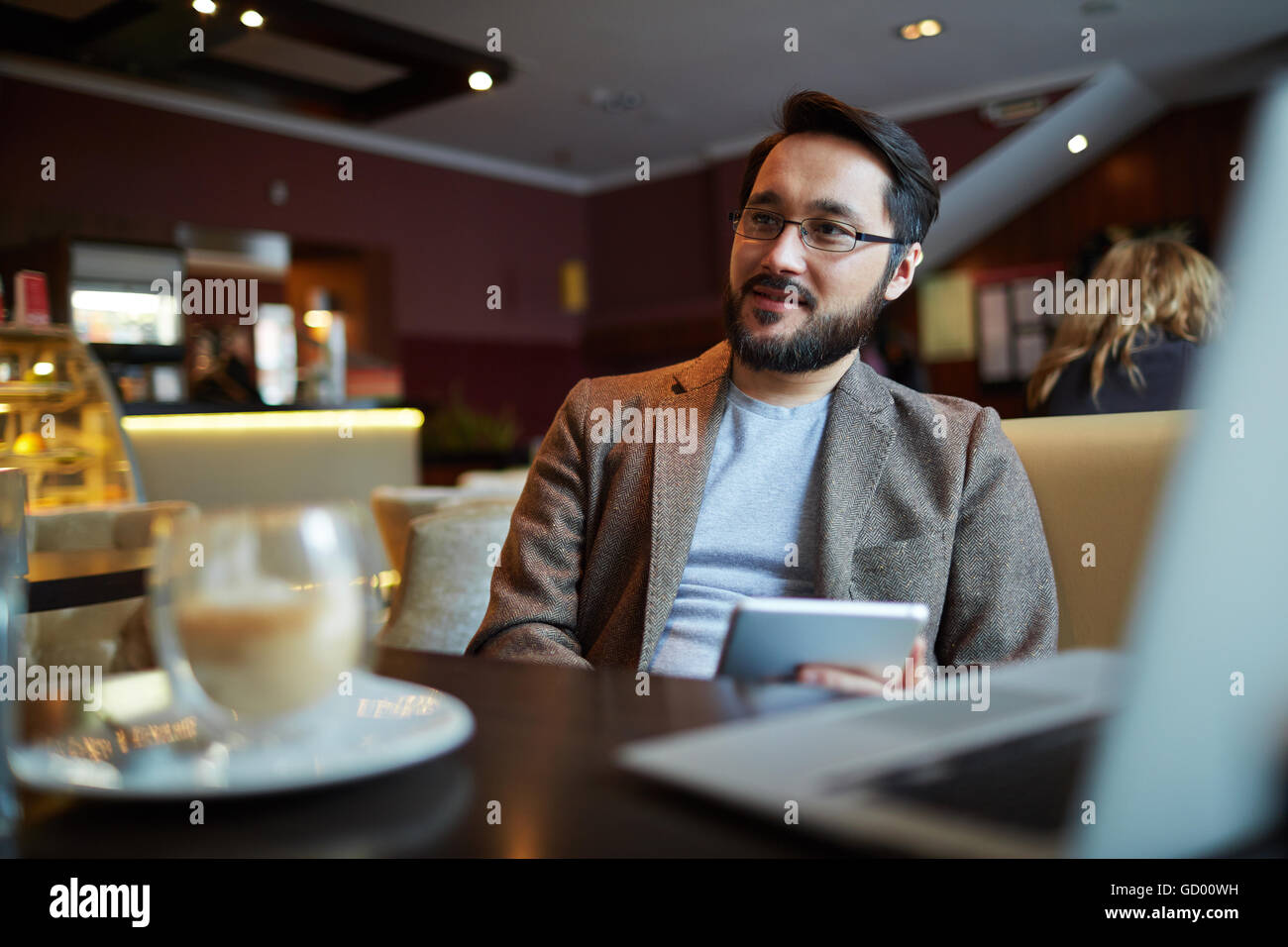 Man at cafe Stock Photo