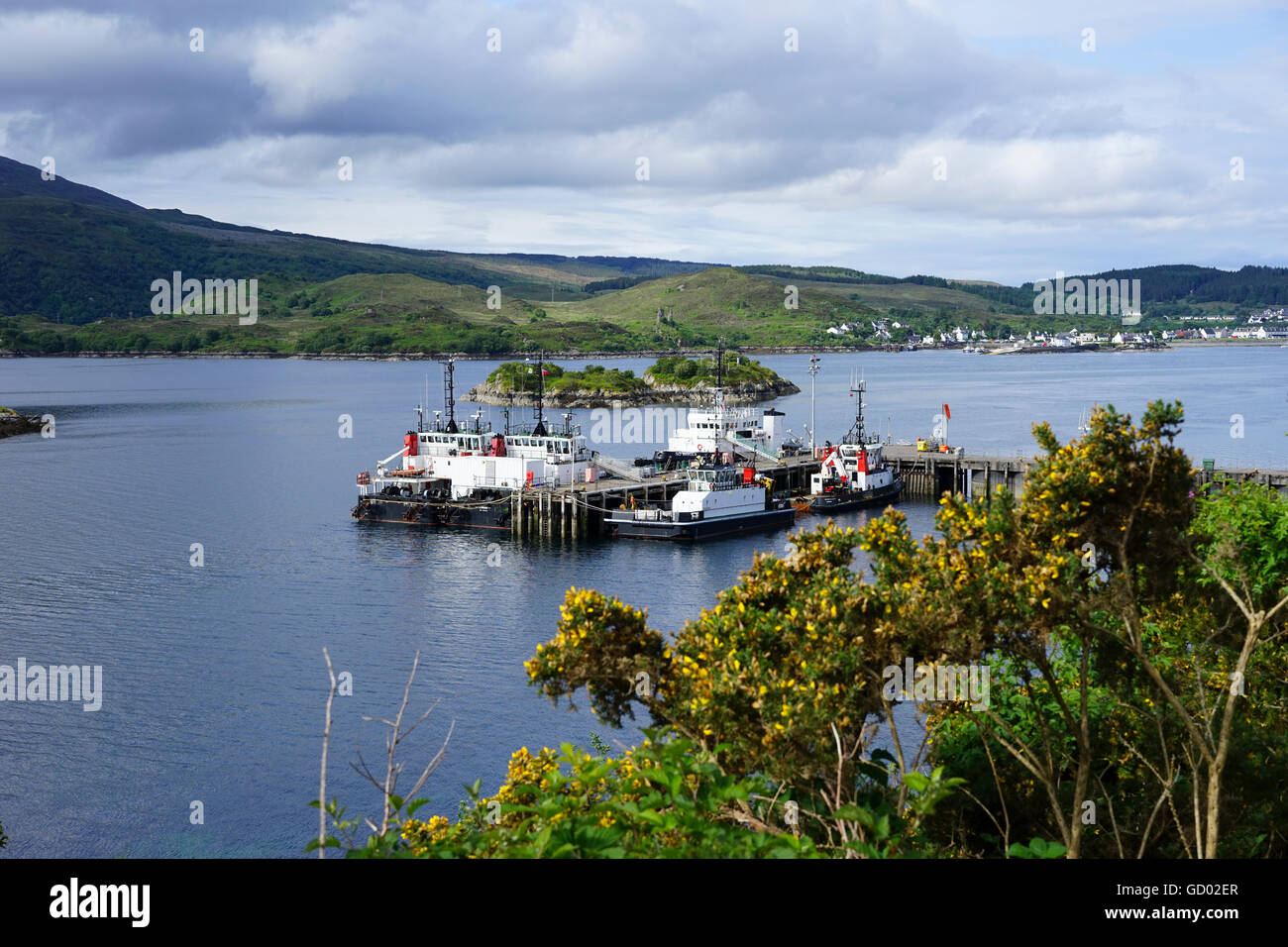 Tugs and working boats moored in Loch Alsh, Highland, Scotland, UK. - Stock Image