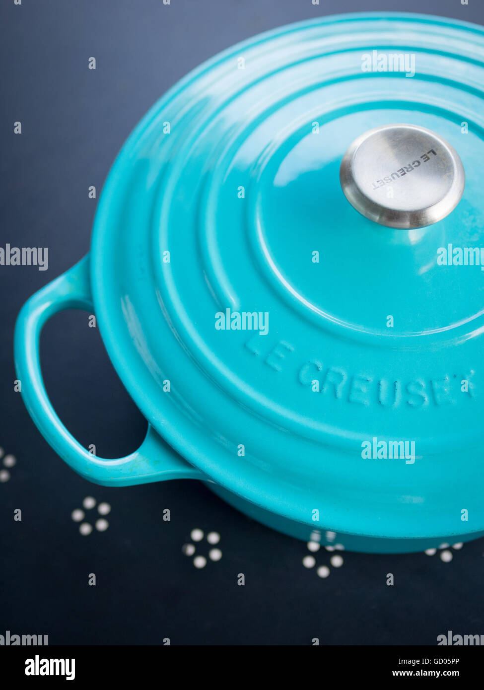 A signature Le Creuset enameled cast-iron French oven in 'Caribbean' (turquoise) colour. - Stock Image