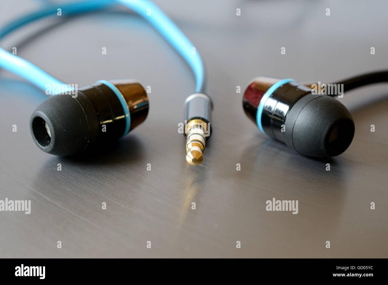 Earphones and jack plug closeup. Shallow depth of field. Stock Photo
