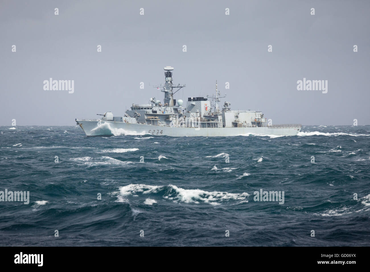 Portsmouth-based warship HMS Iron Duke in the Southern North Sea as she returns home from a successful six-month - Stock Image