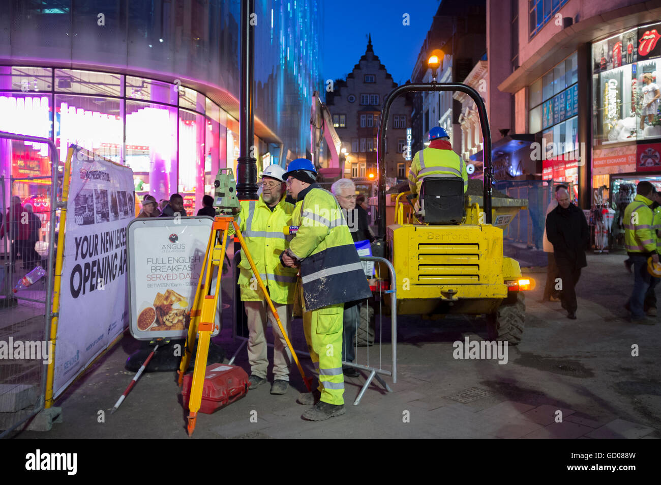 Workmen working late on the revamping of Leicester Square, London January 2012 - Stock Image