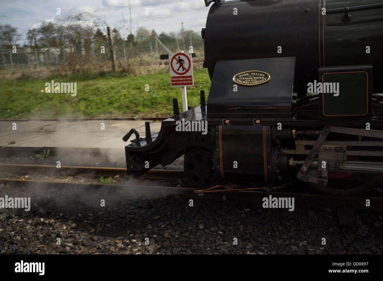 Steam train on the Bure Valley 15 inch (381mm) minimum gauge heritage railway in Alysham, Norfolk, England - Stock Image