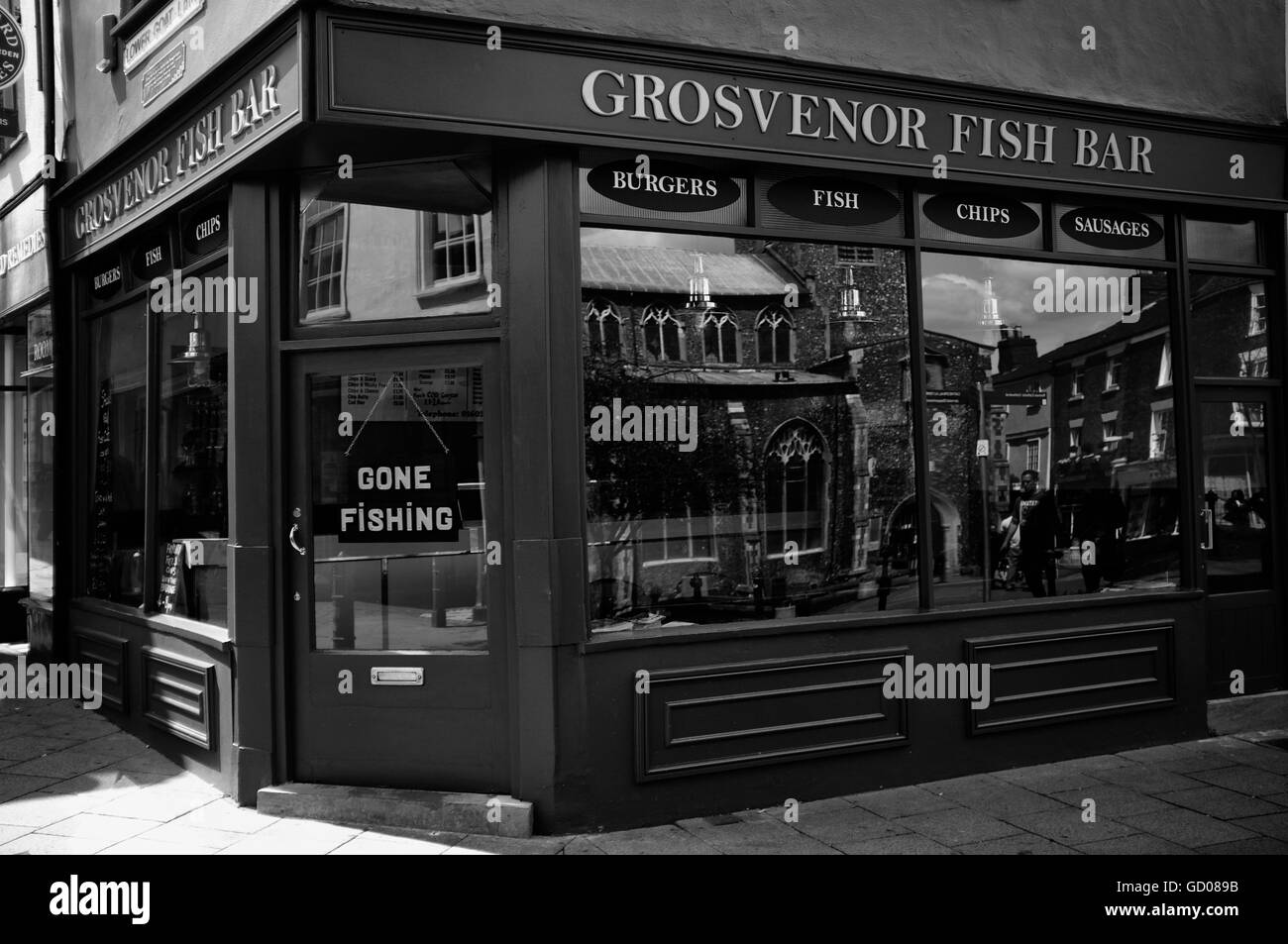 Grosvenor Fish and Chip shop, Norwich Lanes, Norwich, Norfolk with a Gone Fishing sign in the window to indicate - Stock Image