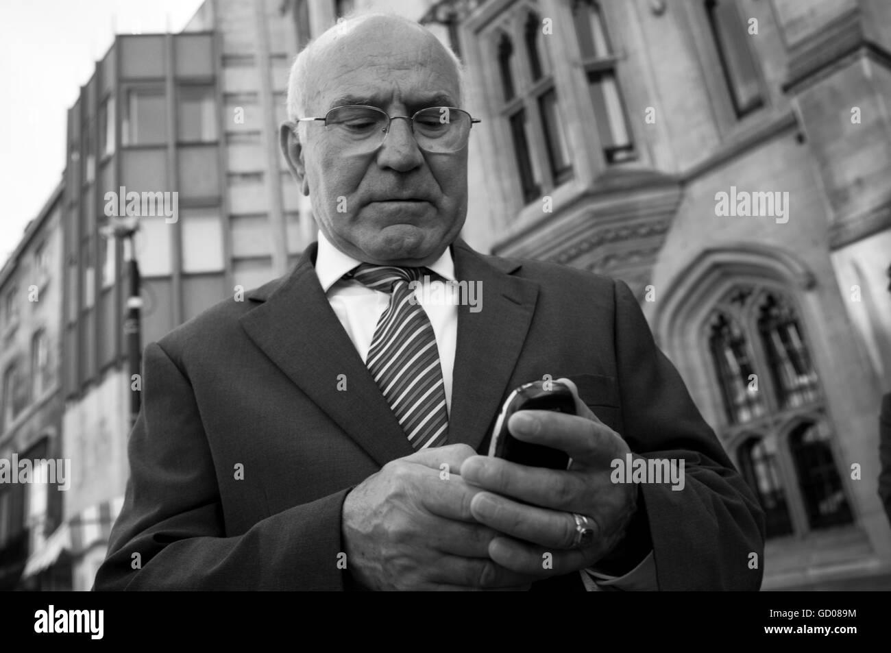 Oder gentleman using his mobile phone - Stock Image