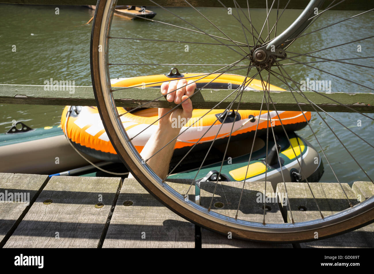 Mans hand emerging out of the River Cam - Stock Image