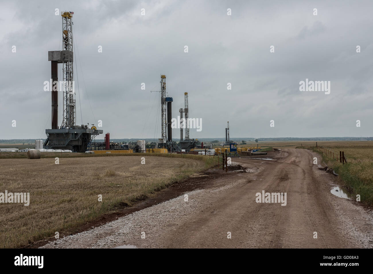 Fracking oil rig drills in Oklahoma field. - Stock Image