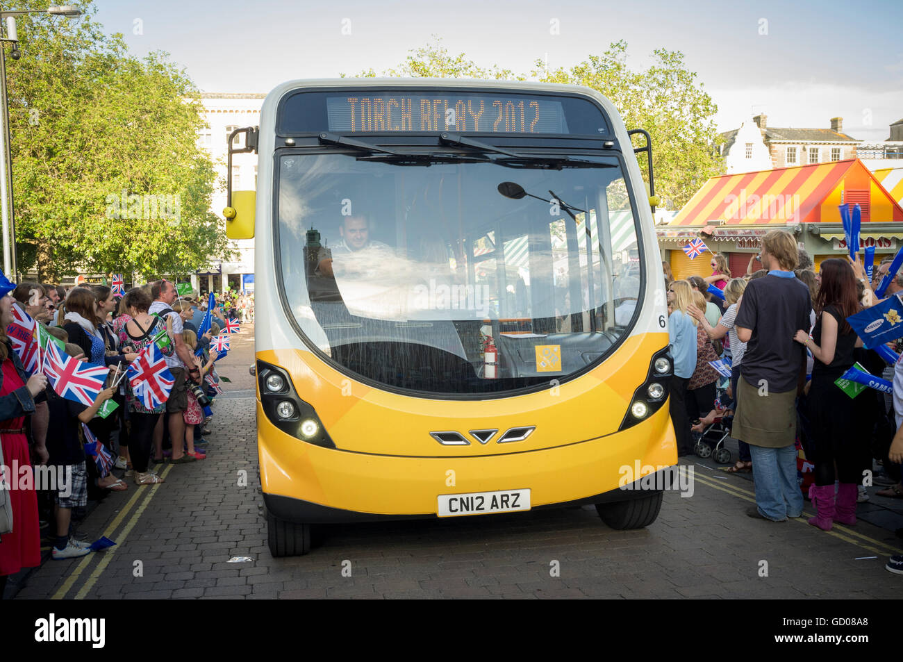 Coach preceding arrival of the 2012 Olympic Torch rally through Norwich, - Stock Image