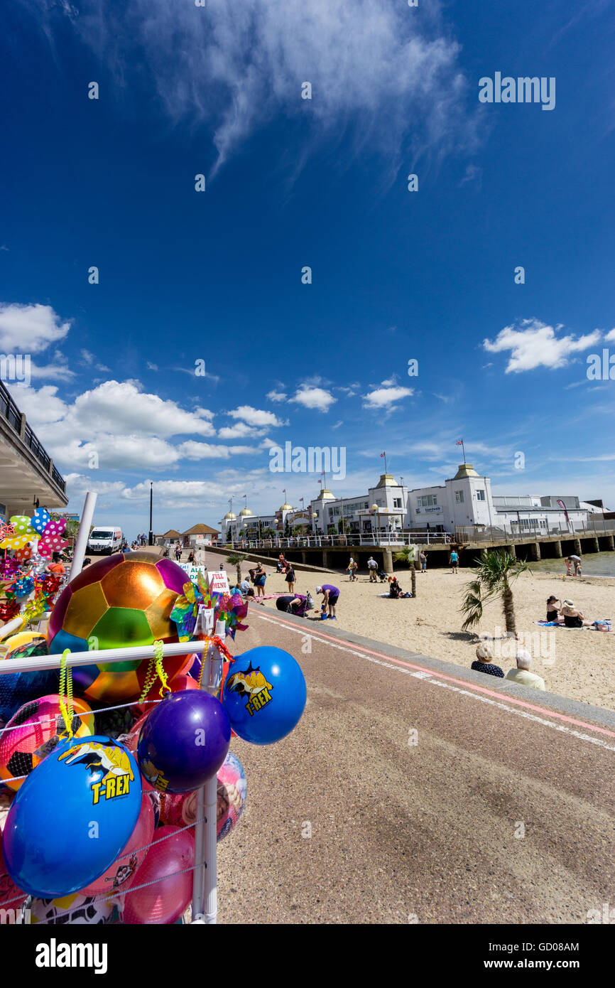 Seafront and pier, Clacton-on Sea, Essex, UK - with beach toys for sale - Stock Image