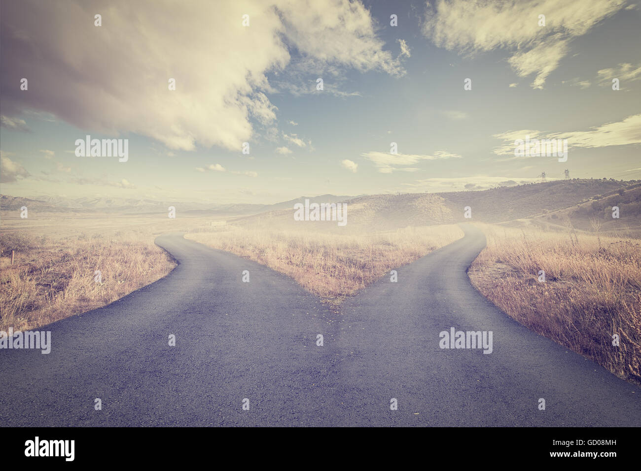 Concept of choice with crossroads spliting in two ways - Stock Image