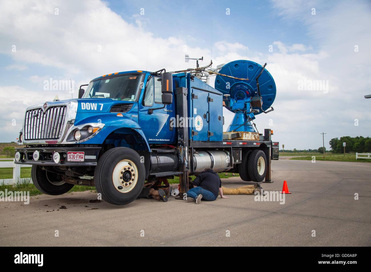 A Doppler on Wheels truck designed to scan tornadoes with Doppler Radar undergoes maintenance in Ansley, Nebraska, - Stock Image