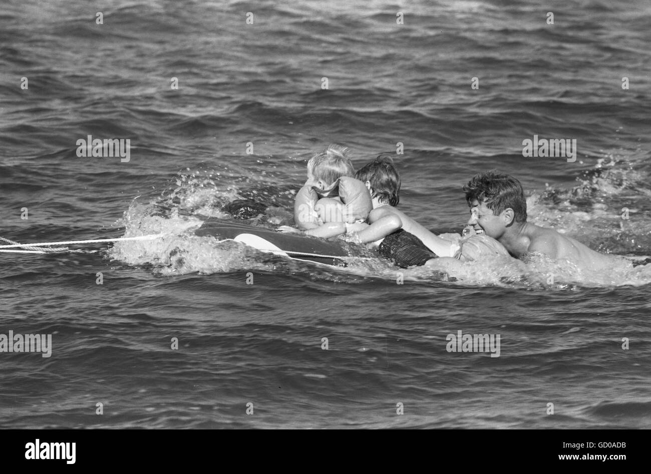 John F. Kennedy with children, swimming - Stock Image