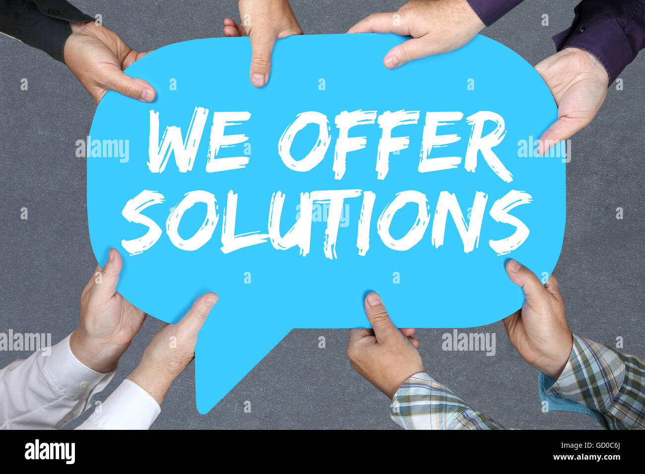 Group of people holding with hands the word solutions solution for problem business concept success help - Stock Image