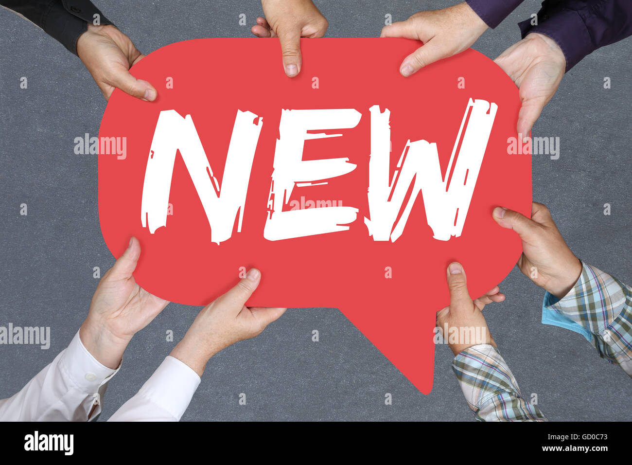 Group of people holding with hands the word new promotion information advertising advertisement business concept - Stock Image