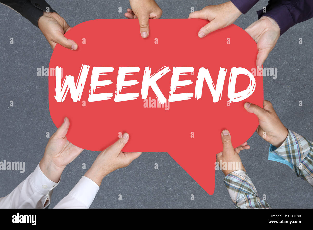 Group of people holding with hands the word Weekend relax relaxed break business concept free time freetime leisure - Stock Image