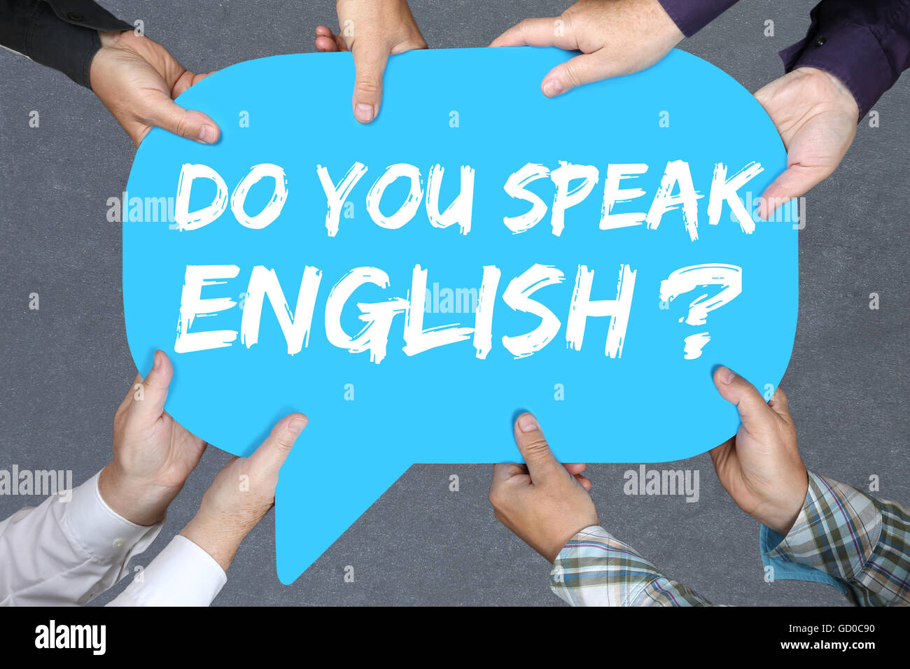 Group of people holding with hands the word Do you speak English foreign language learning school Stock Photo