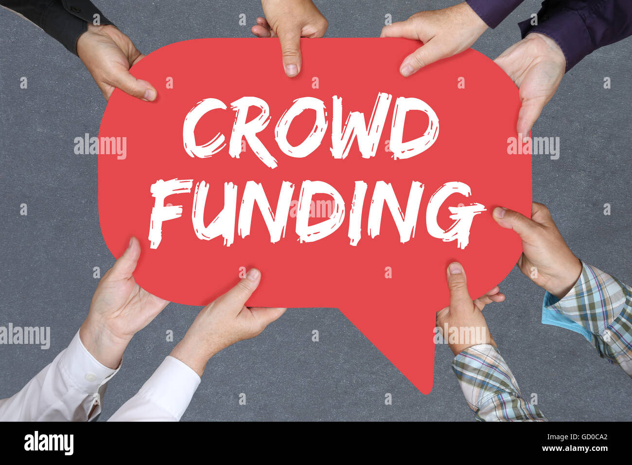 Group of people holding with hands the word crowd funding crowdfunding collecting money online investment internet - Stock Image