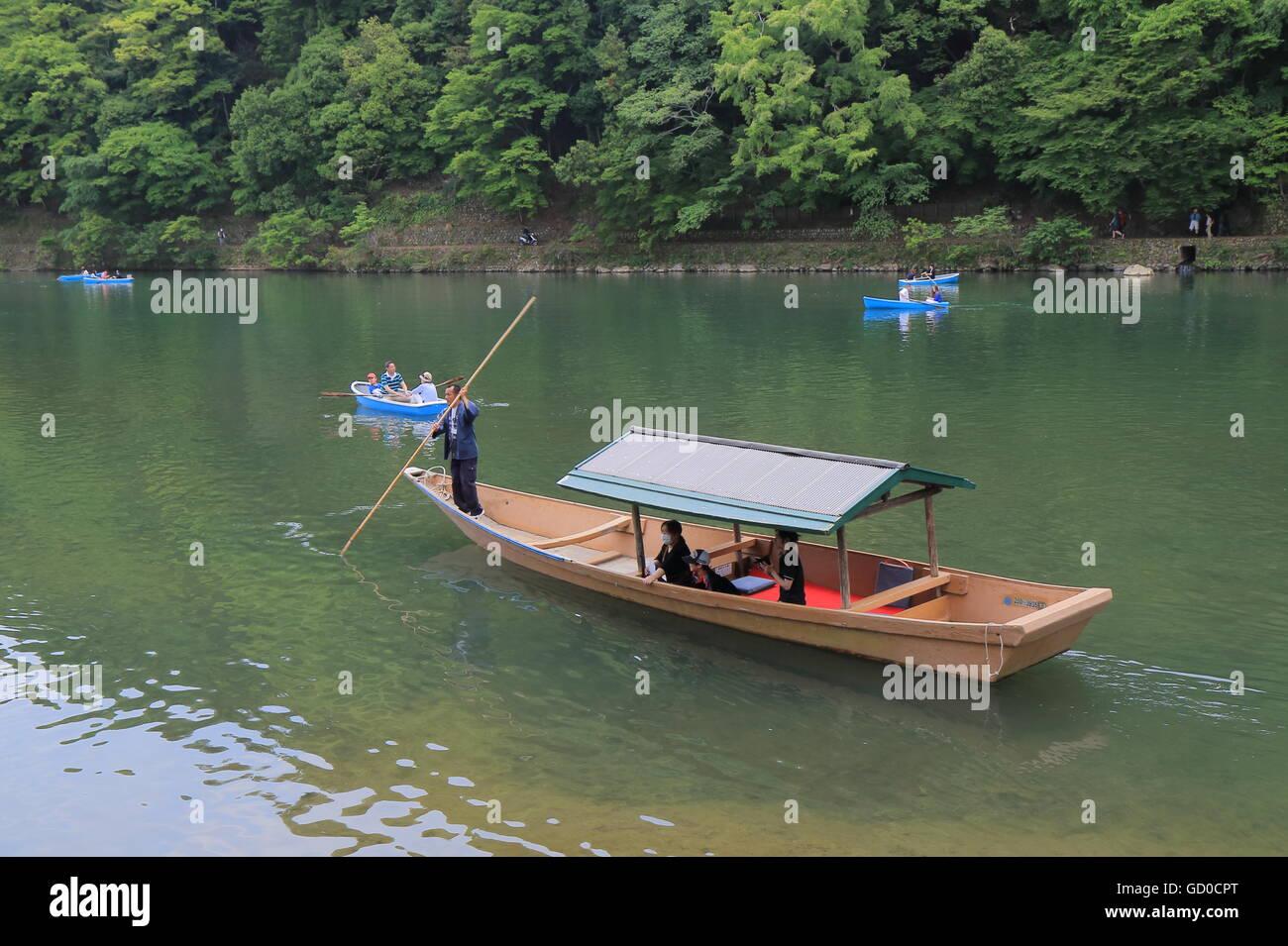 People take river cruise boat in Arashiyama Kyoto Japan. - Stock Image