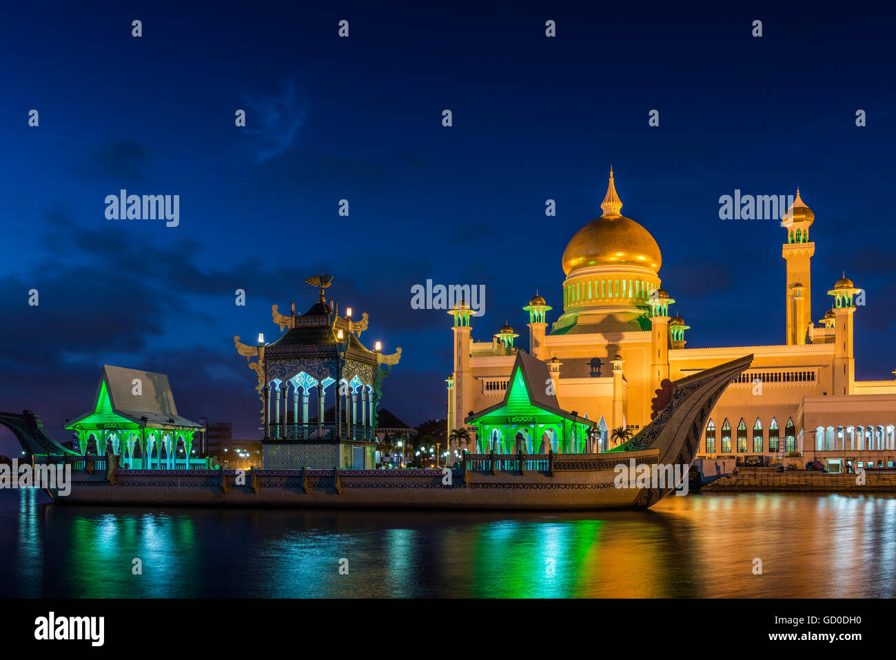 The Sultan Omar Ali Saifuddin Mosque in Bandar Seri Begawan, Brunei, lit up at night. - Stock Image