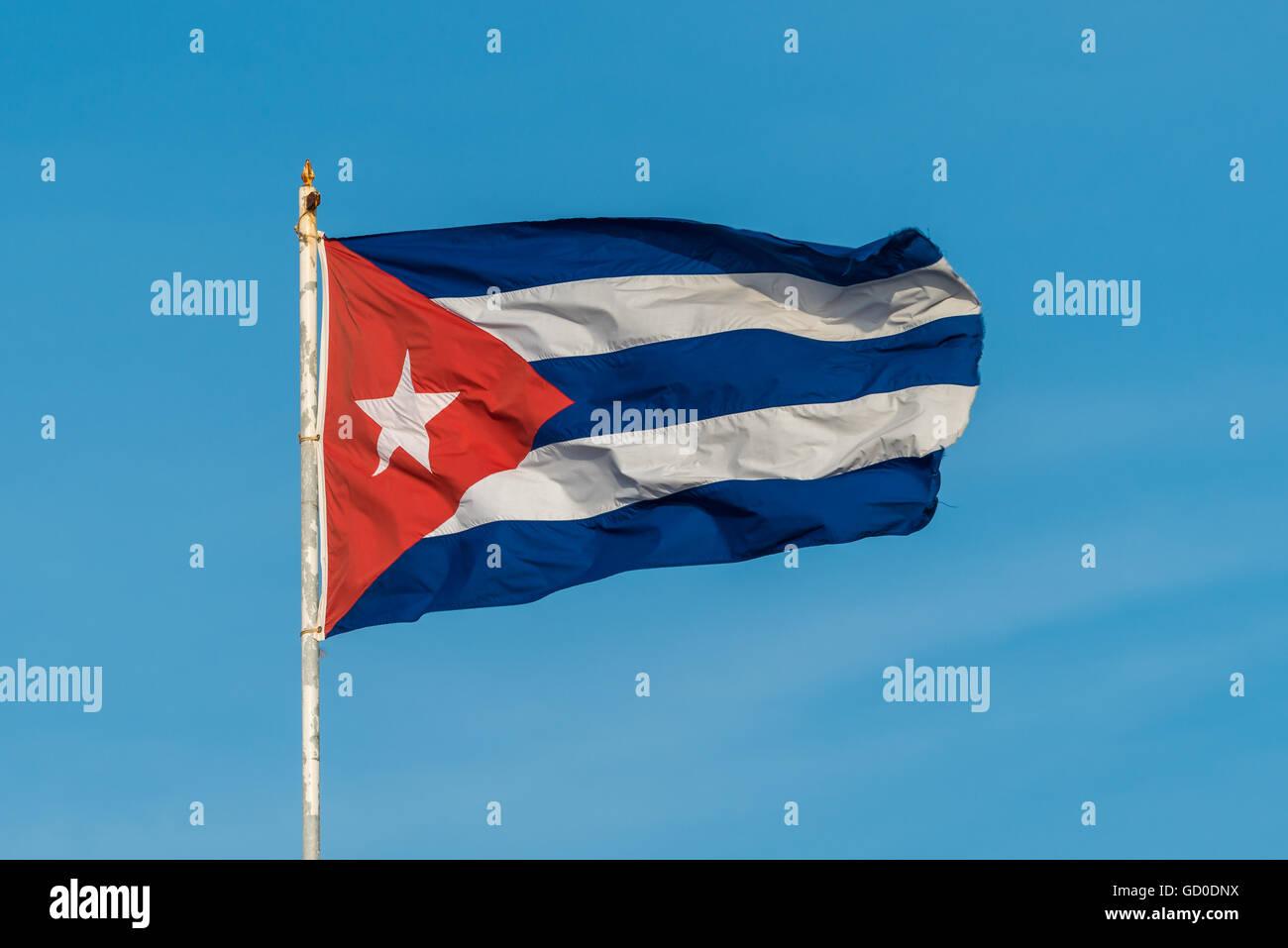 A Cuban flag flies high above the city of Havana. - Stock Image