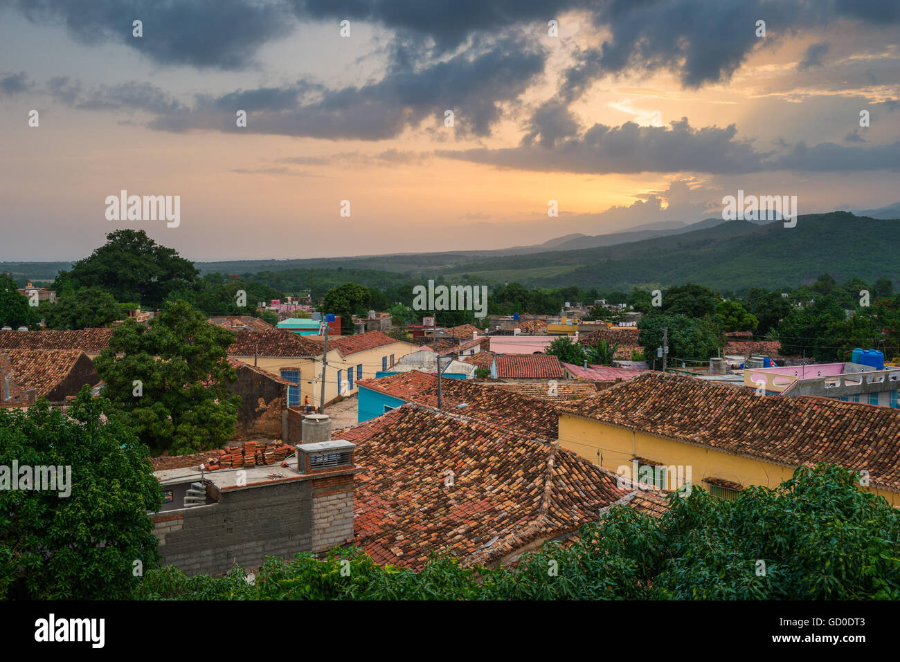 The sun sets over the rooftops of Trinidad, Cuba. - Stock Image