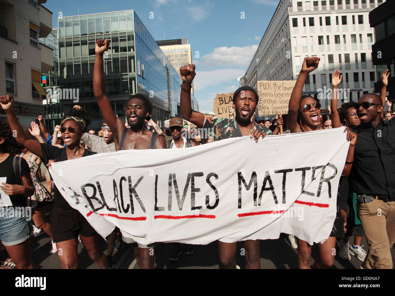 Demonstrators held a banner with the motto of the black civil rights movement 'Black Lives Matter' to show - Stock Image
