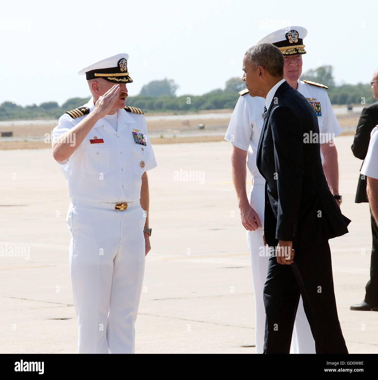 Rota, Spain. 10th July, 2016. U.S President Barack Obama is welcomed by Capt. Michael MacNicholl, the commanding - Stock Image
