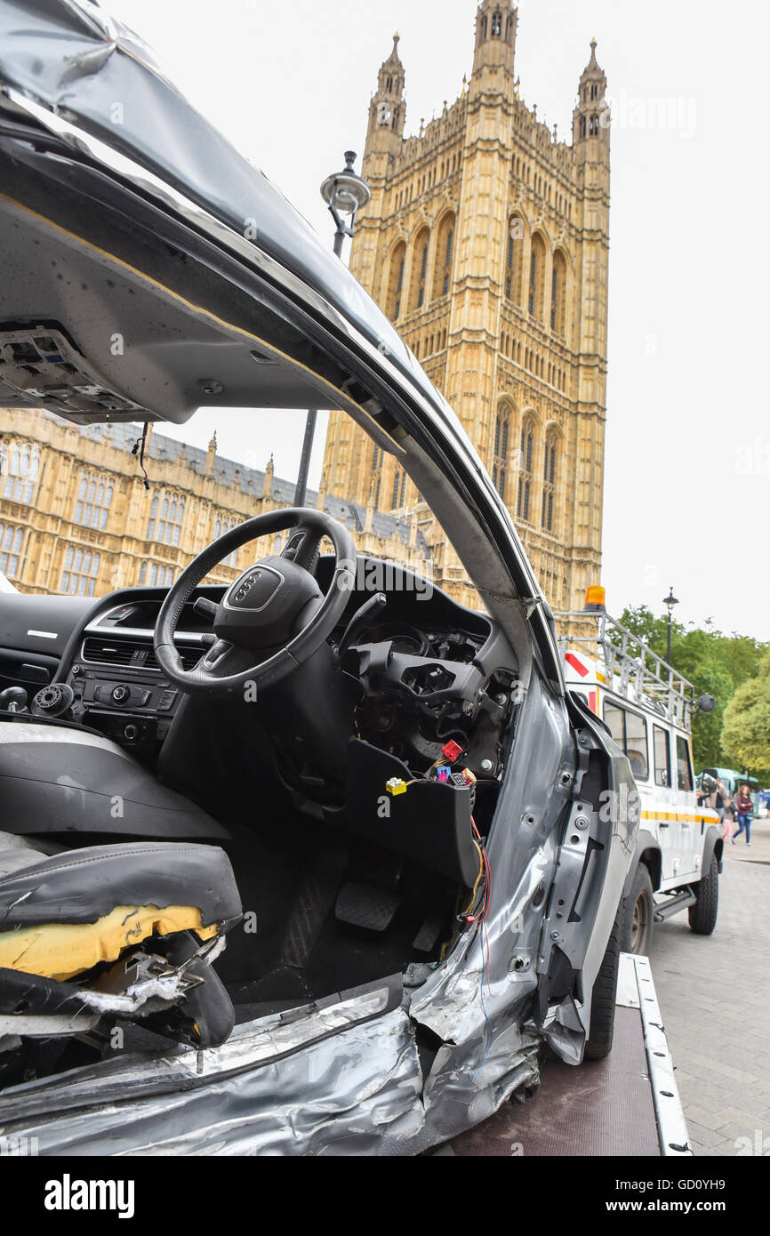 Westminster, London, UK. 11th July 2016. The remains of the car opposite Parliament in which Joseph Brown-Lartey Stock Photo